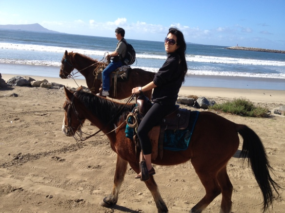 Riding on horses by the beach in Ensenada, Mexico