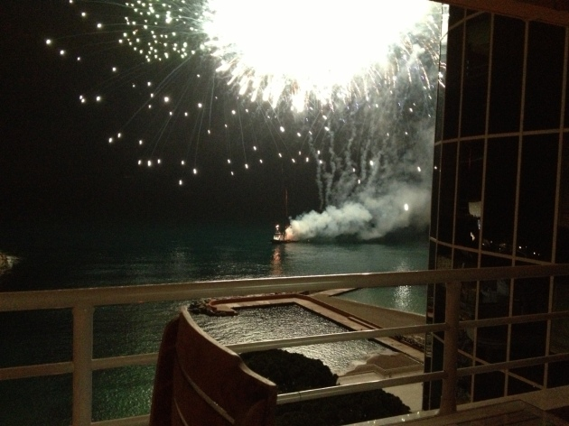 Fireworks playing at night right outside our hotel on the water!